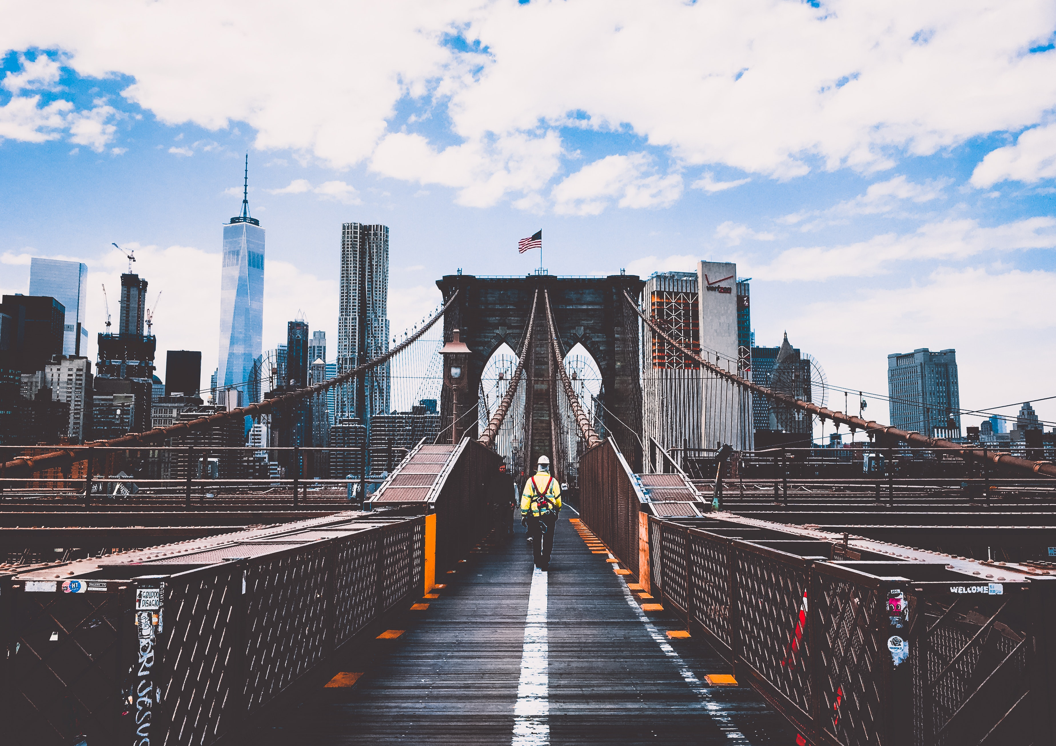 A person walking on Brooklyn bridge ,New York after moving from Queens to Brooklyn